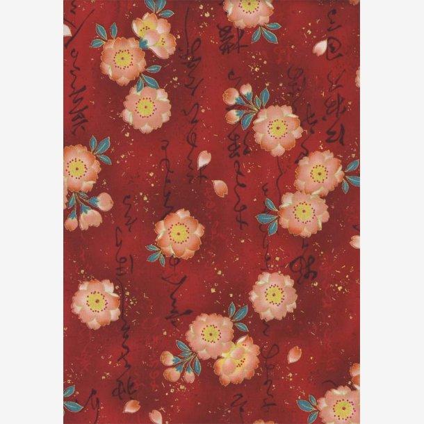 Ferskenfarvede blomster på rød