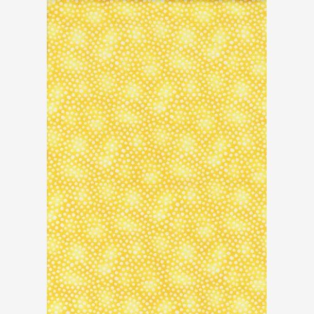 Hvide prikker på gul