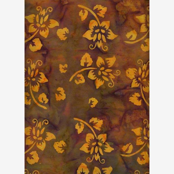 Gule blomster på gyldenbrun