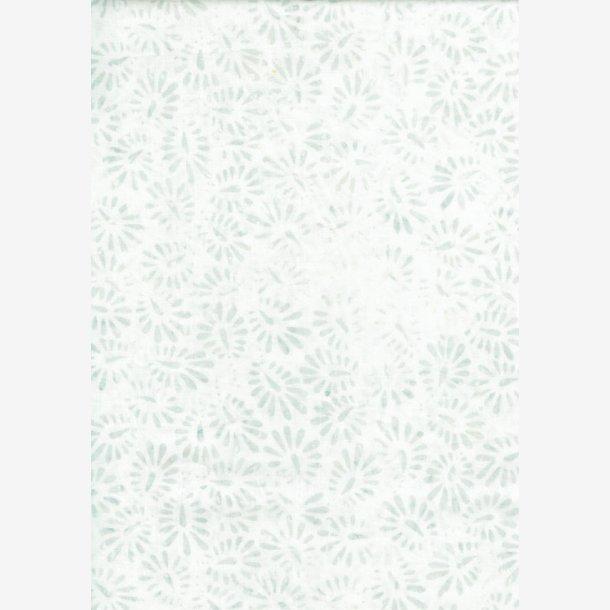 Små lysegrå 'frø' på hvid
